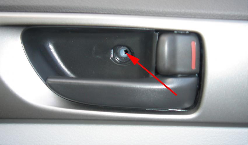 09 Forester heated mirror upgrade-doorscrew.jpg