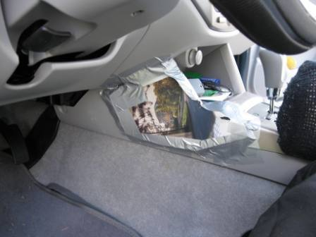 Solutions for Drivers Seat problems: back pain and leg pain-mousepad-duct-taped-over-center-console.jpg
