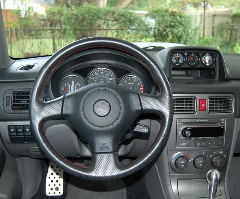 05 STI steering wheel with cruise swap into an 04 XT