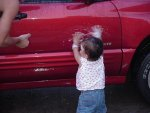 Malia washing car.JPG